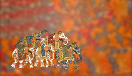 Caparisoned elephants  on bright colored background  in  India
