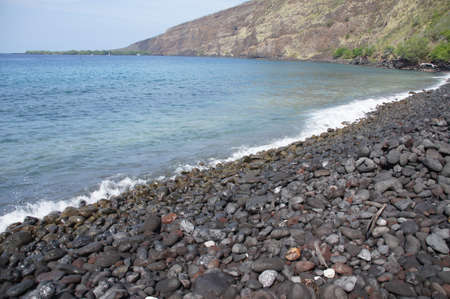 igneous: Surf and eroded lava rocks  on beach at Kealakekua Bay State Historical Park Hawaii