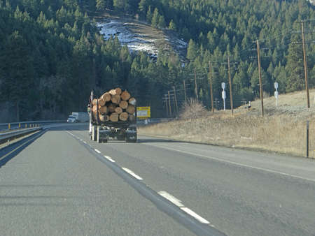 logging truck: Logging truck  carries huge logs Glenwood Canyon,  Colorado   Stock Photo