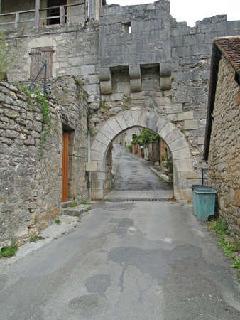 Medieval gate  in city walls of  Rocamadour, France   Stock fotó