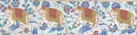 Caparisoned elephants  on bright Islamic pattern tiles