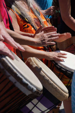 Close up of drumming by woman in bright clothes, Penticton, British Columbia, Canada..   Stock Photo