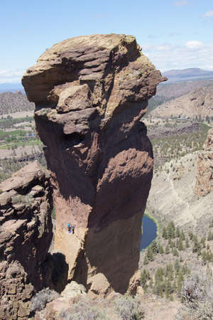 Climbers on  the overhanging cliff of Monkey Face, one iof the premier climbs in the Smith Rock area, Central Oregon