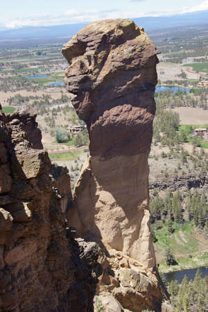 Climbers on  the overhanging cliff of Monkey Face, one iof the premier climbs in the Smith Rock area, Central Oregon   photo