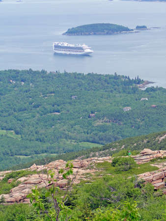 Pink granite boulders  on summit of Cadillac Mountain, with cruise ship  in background, on Mount Desert Island, Acadia National park, Maine, New England