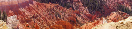 eroded: Panorama, fantasticly eroded red Navajo sandstone pinnacles and cliffs Cedar Breaks National Monument, Utah