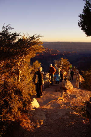 GRAND CANYON, ARIZONA - SEP 27 - Tourists enjoy the sunset from Imperial Point  on Sep 27, 2013 just before the government shutdown, at the Grand Canyon National Park, Arizona