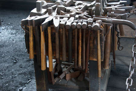 Tools of the blacksmith  in the only 19th century whaling smithy still operating.  Old Mystic Seaport, Connecticut