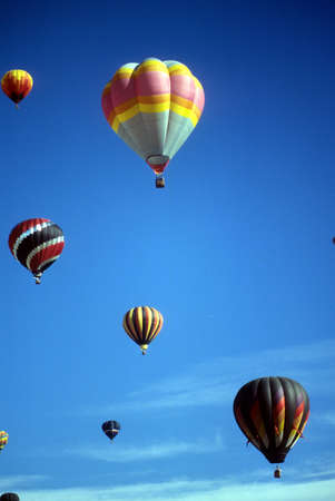Hot air balloons against blue sky, International Balloon Festival, Albuquerque, New Mexico photo