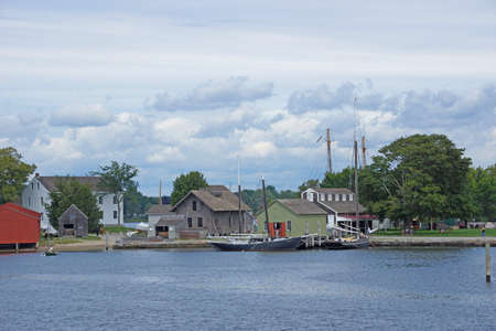 19th century sailing ships and riverside wharfs  along the Thames river, of Old Mystic Seaport, Connecticut