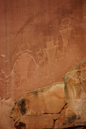 anasazi: Petroglyphs of the Anasazi Native American people on red sandstone wall in Capitol Reef National Park, Utah