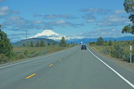 A mirage distorts traffic images  on highway heading toward Mt. Hood, Oregon