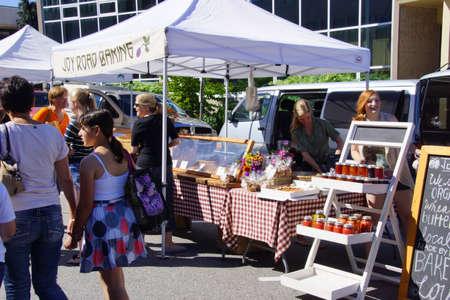 PENTICTON, BRITISH COLUMBIA - Jun 15 - Tourists sample the baked goods at the Saturday market on Jun 15, 2013 in Penticton, British Columbia, Canada.  Stock fotó - 23851401