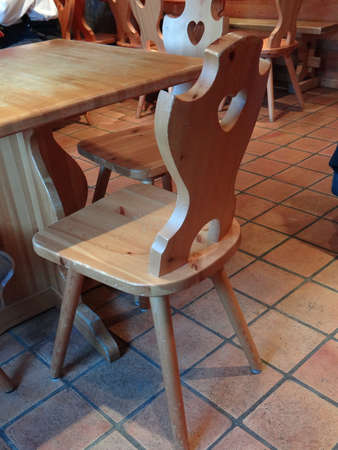 Wooden table and chairs  at a small restaurant  in the alpine village of Chatel, France