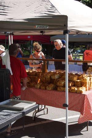 PENTICTON, BRITISH COLUMBIA - Jun 15 - Tourists sample the baked goods at the Saturday market on Jun 15, 2013 in Penticton, British Columbia, Canada.