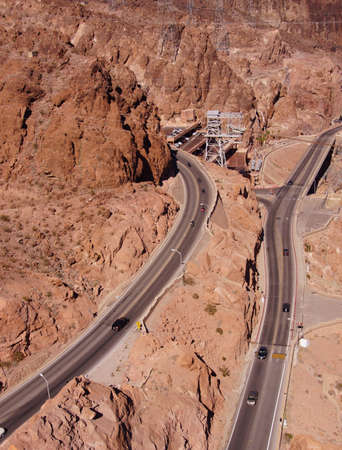 Highways hug the steep, narrow canyon in front of Hoover Dam,  on the border of Arizona and Nevada   photo