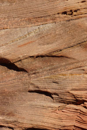 sedimentary: Detail, cross current layers of red sandstone, created from fossilized dunes and shifting winds over millions of years, Zion National Park, Utah