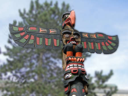 victoria bc: Totem pole topped  by thunderbird, Thunderbird Park, Victoria, BC, Canada