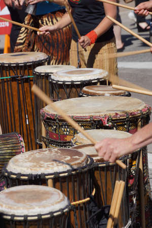 Drums played by women  in brightly colored clothes, Penticton, British Columbia, Canada..
