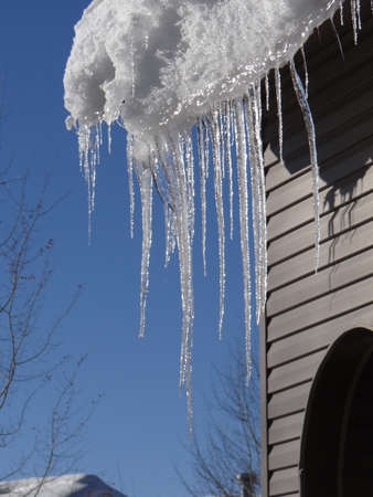 springs: Large icicles hanging from condominium roof, Steamboat Springs, Colorado