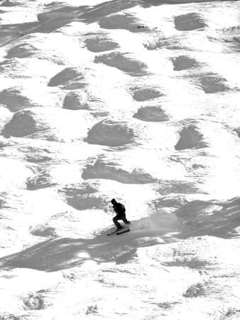 Silhouette of skier in the moguls and bumps of  the Tornado piste run Steamboat Springs, Colorado