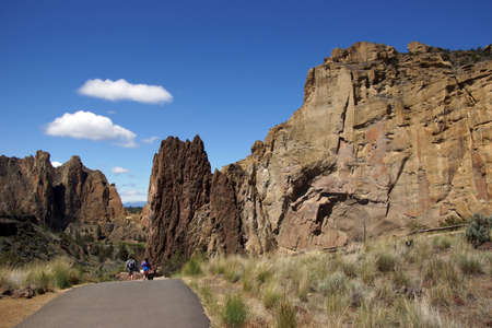 smith rock: Hikers drop into the canyon of the Crooked River  in Smith Rock State Park, Central Oregon.   Stock Photo