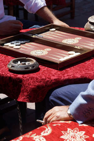 Two men playing a game of backgammon (tavla) in a teahouse  in Istanbul, Turkey   Editorial