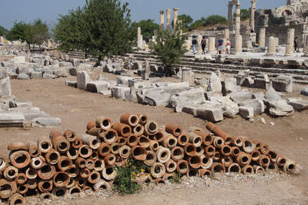 terra: Ancient terra cotta pipe sections used for drains in the Roman city of  Ephesus, Turkey