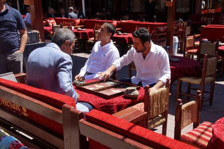 ISTANBUL, TURKEY - MAY 16, 2014 -Two men enjoying a game of backgammon (tavla) in a teahouse  in Istanbul, Turkey