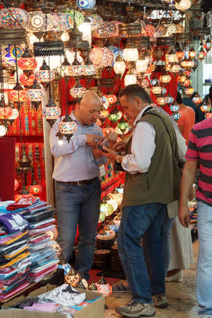 ISTANBUL - May 13, 2014 - Shoppers explore the maze of the Grand Bazaar (Kapali carsi ) in Istanbul, Turkey