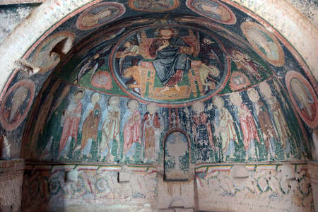 Jesus Christ and his apostles, Damaged Christian frescoes in the  Hacli (Cross) Church, Kizilcukur Valley, Cappadocia.  Turkey