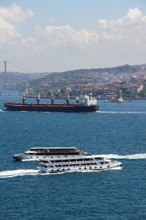 criss cross: ISTANBUL - MAY 18, 2014 - High speed commuter ferries criss cross the Bosphorus linking European and Asian parts of Istanbul