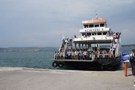 disembark: CANAKKALE, TURKEY - MAY 23, 2014 - Passengers prepare to disembark the ferry after crossing  the Dardanelles  from Gallipoli,  near Canakkale,  Turkey