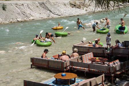 SAKLIKENT, TURKEY - MAY 31, 2014 - Tourists prepare to enter the whitewater  emerging from Saklikent gorge in  Turkey