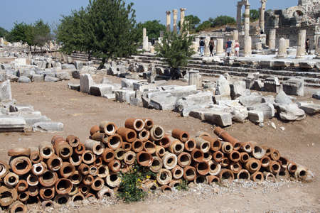terra cotta: Ancient terra cotta pipe sections used for drains in the Roman city of  Ephesus, Turkey  Stock Photo