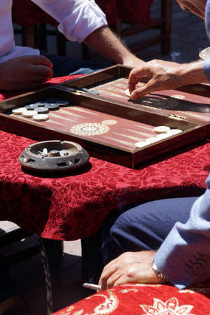 Two men playing a game of backgammon (tavla) in a teahouse  in Istanbul, Turkey