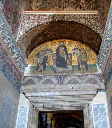 vestibule: Constantine and Justinian make offerings to the Blessed Virgin Mary and her son, Jesus,  in a 10th century mosaic in the Vestibule of the Warriors of  Hagia Sophia  in Istanbul, Turkey   Editorial