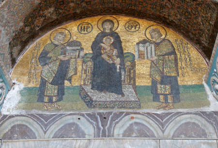 justinian: Constantine and Justinian make offerings to the Blessed Virgin Mary and her son, Jesus,  in a 10th century mosaic in the Vestibule of the Warriors of  Hagia Sophia  in Istanbul, Turkey   Editorial
