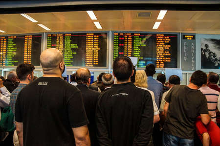 ISTANBUL, TURKEY - MAY 15, 2014 -Arriving passengers run the gauntlet of travel guides as they exit customs area of the airport  in Istanbul, Turkey