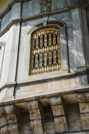 Golden grillwork on exterior wall  of the Topkapi Palace in Istanbul, Turkey