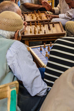 tea house: Typical tea house scene with men playing boardgames and talking  in Urfa bazaar,  Turkey