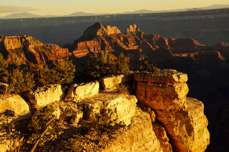 alpenglow: Alpenglow paints the cliffs and ridges after sunset  from  the North Rim of the Grand Canyon National Park, Arizona Stock Photo