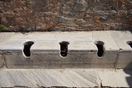 latrine: Public toilet from ancient Roman times  Ephesus, Turkey   Stock Photo