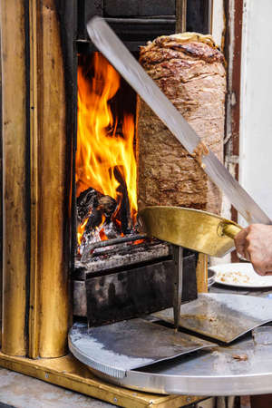 kabab: Cook slices shawarma from the spit for doner kababs  in Mardin,  Turkey