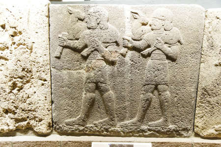 Young male servants of Kubala carrying sacrificial animals, Orthostat of Procession in Kargamis near Gaziantep, 900-700 BCE Museum of Anatolian Civilization,  Ankara, Turkey