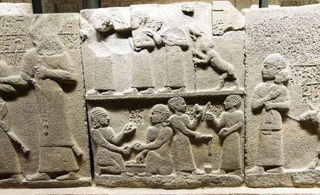 orthostat: Children of the King playing games, Royal buttress in Kargamis near Gaziantep, 900-700 BCE Museum of Anatolian Civilization,  Ankara, Turkey Editorial