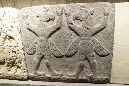 Bird headed winged figures, Griffin Demons carry the heavens, Orthostat of Procession in Kargamis near Gaziantep, 900-700 BCE Museum of Anatolian Civilization,  Ankara, Turkey