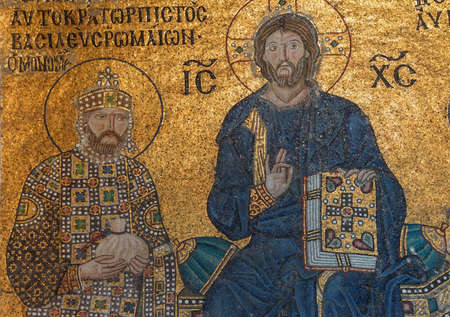 enthroned: Christ enthroned, flanked by  Constantine IX Monomachus, husband of Empress Zoe,  Byzantine mosaic in the gallery of  Hagia Sophia  in Istanbul, Turkey Stock Photo