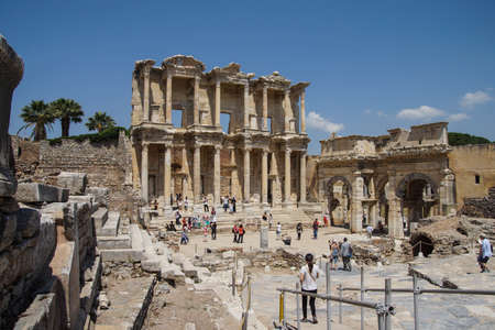 EPHESUS, TURKEY - MAY 25, 2014 - Tourists explore and photograph the Library of Celsus  Ephesus, Turkey Editorial