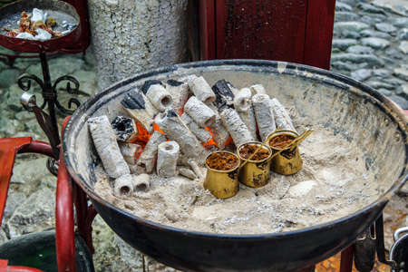 Turkish coffee brewed on charcoal in traditional method,  Safranbolu, Turkey Stock Photo